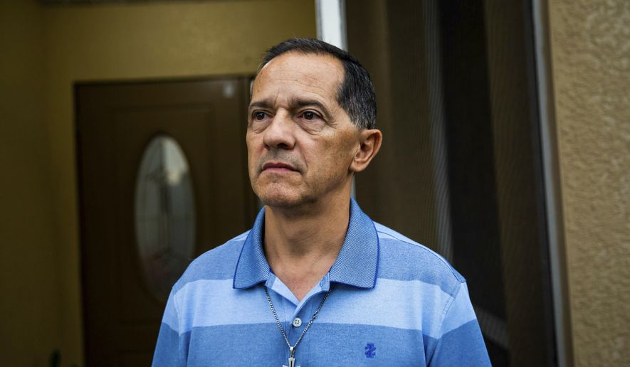 Diego Grisales at his home in Fort Myers, Florida, on July 3, 2019. With his family, Grisales moved from Colombia to Florida due to concerns for his family's safety. Now, he and his wife are United States citizens. (Morgan Hornsby/Naples Daily News via AP)
