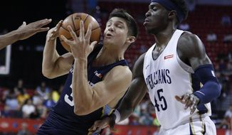Memphis Grizzlies' Grayson Allen drives into New Orleans Pelicans' Zylan Cheatham during the second half of an NBA summer league basketball game Sunday, July 14, 2019, in Las Vegas. (AP Photo/John Locher)