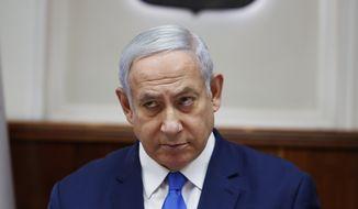Israeli Prime Minister Benjamin Netanyahu attends the weekly cabinet meeting in Jerusalem, Sunday, July 14, 2019. (Ronen Zvulun/Pool Photo via AP)