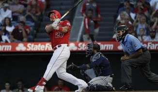 Los Angeles Angels' Mike Trout follows through on a two-run home run against the Seattle Mariners during the third inning of a baseball game Saturday, July 13, 2019, in Anaheim, Calif. (AP Photo/Marcio Jose Sanchez)