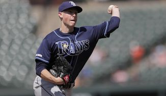 Tampa Bay Rays relief pitcher Ryan Yarbrough throws to the Baltimore Orioles in the ninth inning of a baseball game, Sunday, July 14, 2019, in Baltimore. (AP Photo/Julio Cortez)