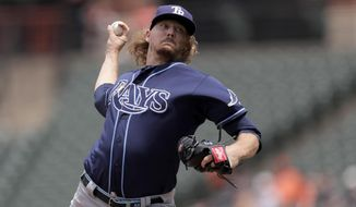 Tampa Bay Rays starting pitcher Ryne Stanek throws to a Baltimore Orioles batter during the first inning of a baseball game, Sunday, July 14, 2019, in Baltimore. (AP Photo/Julio Cortez)