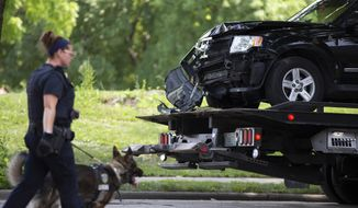 An automobile believed to be driven by a suspect is removed from the scene during an active investigation Saturday, July 13, 2019 in Milwaukee in the 1600 north block of 26th Street into the fatal shooting of a three-year-old girl during a road rage incident Saturday morning.  (Colin Boyle/Milwaukee Journal-Sentinel via AP)