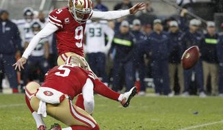 FILE - In this Dec. 16, 2018, file photo, San Francisco 49ers kicker Robbie Gould (9) kicks a field goal from the hold of Bradley Pinion during overtime of an NFL football game to defeat the Seattle Seahawks in Santa Clara, Calif. The 49ers have signed Gould to a four-year contract. The team had placed the franchise tag on Gould in February 2019 for a price tag of about $5 million before signing him to a long-term deal. (AP Photo/Tony Avelar, File)