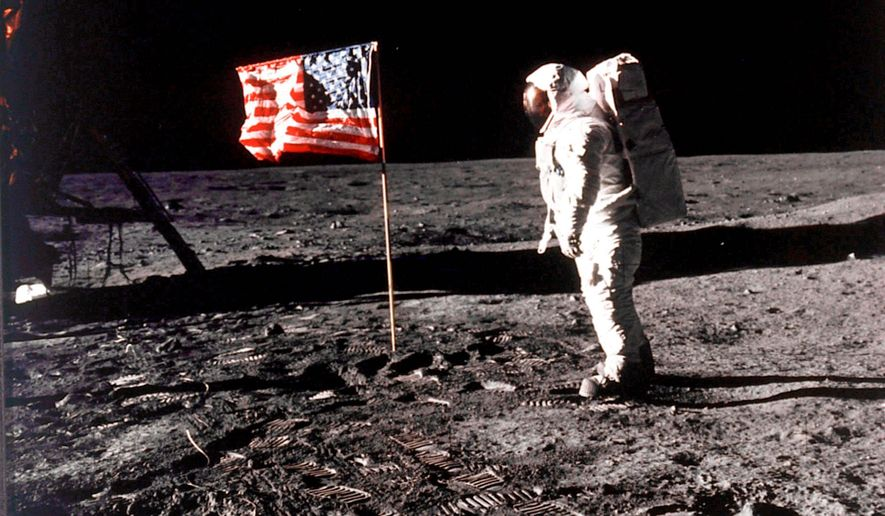 Buzz Aldrin poses with the American flag on the surface of the moon, July 20, 1969.     Associated Press photo