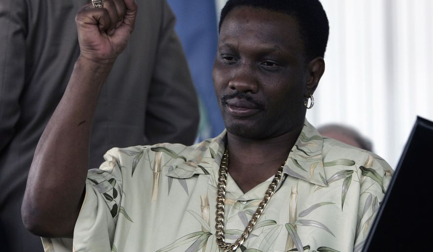 Pernell Whitaker shows off his ring after being inducted into the International Boxing Hall of Fame in Canastota, N.Y., Sunday, June 10, 2007. (AP Photo/Mike Groll)