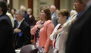 State legislators recite the Pledge of Allegiance at the State House at the start of a special session, Thursday, Aug. 30, 2018, in Augusta, Maine. Lawmakers returned to deal with Maine's struggling child welfare system and the state's tax code. (AP Photo/Robert F. Bukaty)