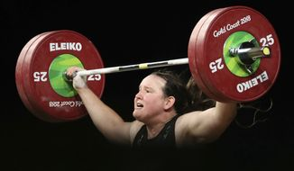 In this Monday, April 9, 2018, file photo, New Zealand's Laurel Hubbard participates in the women's +90kg weightlifting final the 2018 Commonwealth Games on the Gold Coast, Australia. Hubbard, trans female, was warmly welcomed by many spectators during the games, and was the favorite in the over-90-kilograms division but injured herself trying to set a games record. (AP Photo/Mark Schiefelbein) ** FILE **