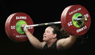 In this Monday, April 9, 2018, file photo, New Zealand's Laurel Hubbard, a trans female, participates in the women's +90kg weightlifting final at the 2018 Commonwealth Games on the Gold Coast, Australia. (AP Photo/Mark Schiefelbein) ** FILE **