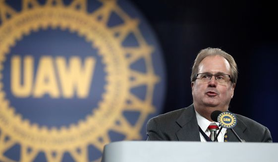 In this March 11, 2019, file photo, Gary Jones, president of the United Auto Workers union, addresses delegates to the union's bargaining convention in Detroit. In recent years, Detroit automakers have been at relative peace with the UAW union because times have been good and profit-sharing checks have been fat. That all could change this week when talks open Monday, July 15, on new four-year contracts with the union representing 142,000 workers across the nation. (AP Photo/Carlos Osorio, File)