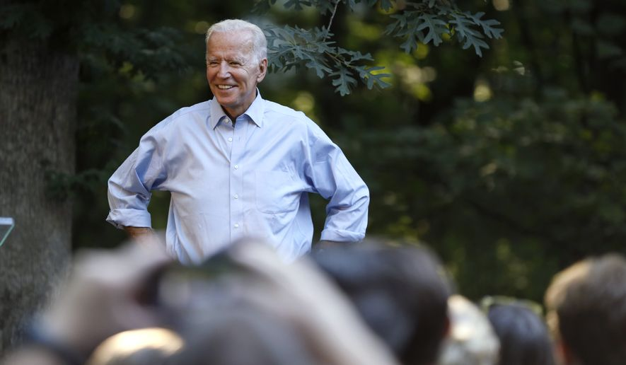 Former Vice President and Democratic presidential candidate Joe Biden arrives to speak at a house party at former Agriculture Secretary Tom Vilsack's house, Monday, July 15, 2019, in Waukee, Iowa. (AP Photo/Charlie Neibergall)