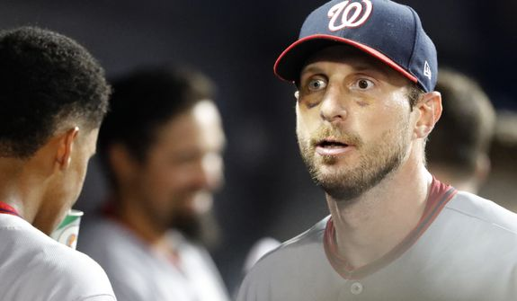 Washington Nationals starting pitcher Max Scherzer walks through the dugout during the ninth inning of a baseball game against the Miami Marlins, Tuesday, June 25, 2019, in Miami. The Nationals defeated the Marlins 6-1. (AP Photo/Wilfredo Lee)