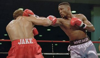 "In this Nov. 18, 1995, file photo, WBC welterweight champion Pernell ""Sweet Pea"" Whitaker, right, delivers a right to the head of challenger Jake Rodriguez during their scheduled 12 round bout in Atlantic City, N.J. Former boxing champion Pernell Whitaker has died after he was hit by a car in Virginia. He was 55. Police in Virginia Beach on Monday say Whitaker was a pedestrian when struck by the car Sunday night, July 14, 2019. The driver remained on the scene, where Whitaker was pronounced dead. (AP Photo/Donna Connor, File) **FILE**"