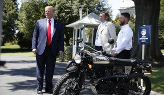 President Donald Trump looks at Janus Motorcycles during a Made in America showcase on the South Lawn of the White House, Monday, July 15, 2019, in Washington. (AP Photo/Alex Brandon)