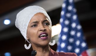 "Rep. Ilhan Omar, D-Minn., respond to remarks by President Donald Trump after his call for the four Democratic congresswomen to go back to their ""broken"" countries, during a news conference at the Capitol in Washington, Monday, July 15, 2019. (AP Photo/J. Scott Applewhite) ** FILE **"