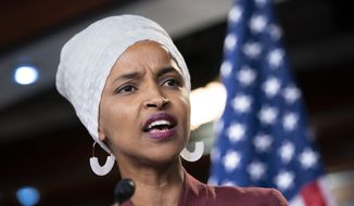 """Rep. Ilhan Omar, D-Minn., respond to remarks by President Donald Trump after his call for the four Democratic congresswomen to go back to their """"broken"""" countries, during a news conference at the Capitol in Washington, Monday, July 15, 2019. All are American citizens and three of the four were born in the U.S. (AP Photo/J. Scott Applewhite)"""