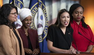 U.S. Rep. Alexandria Ocasio-Cortez, D-N.Y., speaks as, from left, Rep. Rashida Tlaib, D-Mich., Rep. Ilhan Omar, D-Minn., and Rep. Ayanna Pressley, D-Mass., listen during a news conference at the Capitol in Washington, Monday, July 15, 2019. (AP Photo/J. Scott Applewhite) ** FILE **