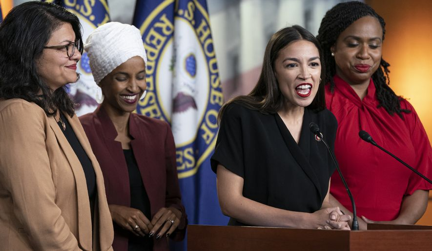 "U.S. Rep. Alexandria Ocasio-Cortez, D-N.Y., speaks as, from left, Rep. Rashida Tlaib, D-Mich., Rep. Ilhan Omar, D-Minn., and Rep. Ayanna Pressley, D-Mass., listen during a news conference at the Capitol in Washington, Monday, July 15, 2019. President Donald Trump on Monday intensified his incendiary comments about the four Democratic congresswomen of color, urging them to get out if they don't like things going on in America. They fired back at what they called his ""xenophobic bigoted remarks"" and said it was time for impeachment. (AP Photo/J. Scott Applewhite)"