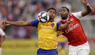 Colorado Rapids forward Niki Jackson (12) and Arsenal forward Tyreece John-Jules go after the ball during the first half of an international friendly soccer match, Monday, July 15, 2019, in Commerce City, Colo. (AP Photo/Jack Dempsey)