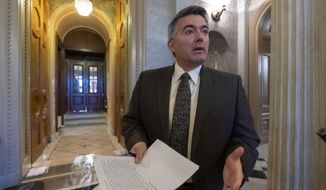 FILE - In this Dec. 31, 2018, file photo, Sen. Cory Gardner, R-Colo., arrives at the Senate Chamber for an abbreviated pro-forma session at the Capitol in Washington. The headquarters of the U.S. government's largest land agency will move from the nation's capital to western Colorado, a Republican senator said Monday, July 15, 2019, a high-profile component of the Trump administration's plan to reorganize management of the nation's natural resources. (AP Photo/J. Scott Applewhite, File)