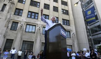Democratic presidential candidate Bernie Sanders, I-Vt., delivers remarks at a rally alongside unions, hospital workers and community members against the closure of Hahnemann University Hospital, background, in Philadelphia, Monday, July 15, 2019. (AP Photo/Jacqueline Larma)