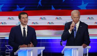In this June 27, 2019, file photo, Democratic presidential candidate South Bend Mayor Pete Buttigieg, left, speaks as former vice president Joe Biden gestures during the Democratic primary debate hosted by NBC News at the Adrienne Arsht Center for the Performing Art in Miami. Biden and Buttigieg represent the generational poles of the crowded Democratic presidential primary. Biden is hoping Democratic voters see his decades of experience as the remedy for Trump's presidency. Buttigieg argues that the moment calls for the energy of a new generation. (AP Photo/Wilfredo Lee, File) **FILE**