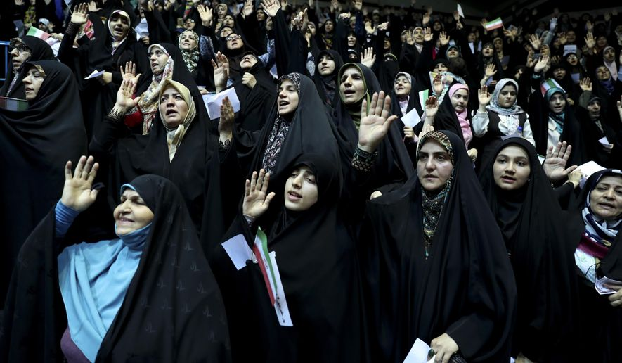 In this Thursday, July 11, 2019 photo, veiled Iranian women attend a ceremony in support of the observance of the Islamic dress code for women, in Tehran, Iran. A few daring women in Iran's capital have been taking off their mandatory headscarves, or hijabs, in public, risking arrest and drawing the ire of hard-liners. Many others stop short of outright defiance and opt for loosely draped scarves that show as much hair as they cover. More women are pushing back against the dress code imposed after the 1979 Islamic Revolution, and activists say rebelling against the hijab is the most visible form of anti-government protest in Iran today.  (AP Photo/Vahid Salemi)