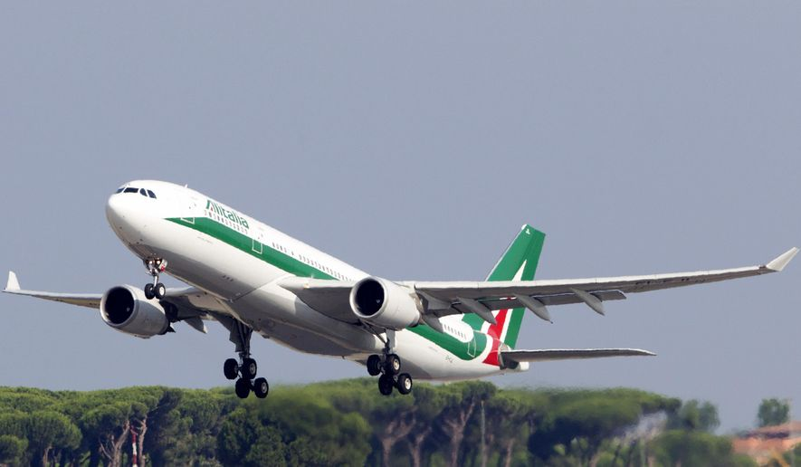 FILE - In this Sunday, July 5, 2015 file photo, an Alitalia plane takes off from Rome's Leonardo Da Vinci international airport. The Italian government is hoping the Alitalia airline will turn a new page after four private investors expressed an interest in joining the state railway, the Italian treasury and Delta Air Lines in trying once again to relaunch the struggling flagship carrier. (AP Photo/Riccardo De Luca, File)