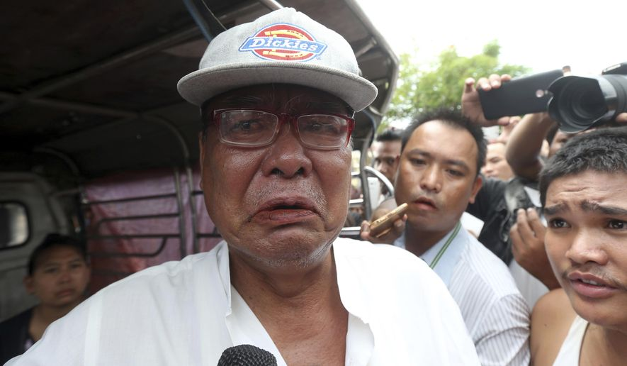Mya Thein, father of rape suspect Aung Gyi, talks to journalists during the court appearance of his son Monday, July 15, 2019, in Nyapyitaw, Myanmar. A court in Myanmar has begun proceedings against a suspect in the rape of a 2-year-old girl at her nursery school that has generated huge public outcry. (AP Photo/Aung Shine Oo)