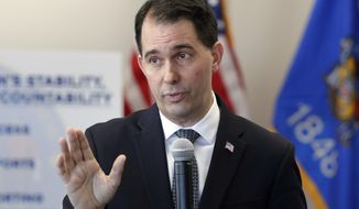 FILE - In this Dec. 14, 2018, file photo, Wisconsin Gov. Scott Walker talks about legislation he signed into law and addressed his transitional agenda as he prepares to leave office during a news conference in Green Bay, Wis. Walker says he won't run for office in 2022 after he accepted a full-time job running a national conservative youth organization. Walker tells the Milwaukee Journal Sentinel in a story published Monday, July 15, 2019, that the job as president of the Young America's Foundation will prevent him from running for his old job as governor or for U.S. Senate in 2022. (Jim Matthews/The Green Bay Press-Gazette via AP, File)