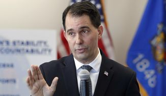 In this Dec. 14, 2018, photo, Wisconsin Gov. Scott Walker talks about legislation he signed into law and addressed his transitional agenda as he prepares to leave office during a news conference in Green Bay, Wis. (Jim Matthews/The Green Bay Press-Gazette via AP) **FILE**