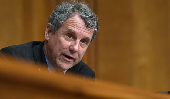 """""""Like a toddler who has gotten his hands on a book of matches, Facebook has burned down the house over and over, and called every arson a learning experience,"""" Sen. Sherrod Brown, Ohio Democrat, said. (Associated Press photographs)"""