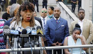 Gwen Carr, mother of chokehold victim Eric Garner, left, speaks outside the U.S. Attorney's office, in the Brooklyn borough of New York, as Garner's widow Esaw Snipes listens at right, Tuesday, July 16, 2019. Federal prosecutors won't bring civil rights charges against New York City police officer Daniel Pantaleo, in the 2014 chokehold death of Garner, a decision made by Attorney General William Barr and announced one day before the five-year anniversary of his death, officials said.  (AP Photo/Richard Drew)