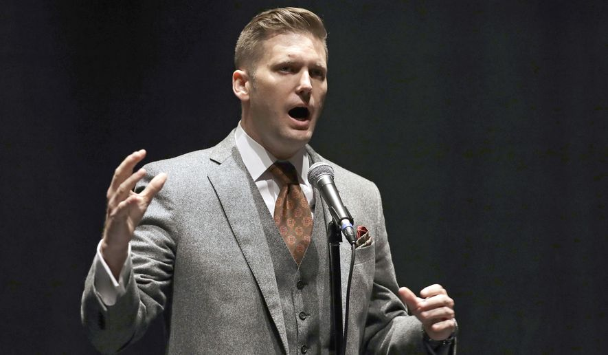 """In this Oct. 19, 2017, file photo, white nationalist Richard Spencer speaks at the University of Florida in Gainesville, Fla. Spencer's wife has accused him of physically, verbally and emotionally abusing her throughout their eight-year marriage. Spencer told The Associated Press on Tuesday, Oct. 23, 2018, that he is """"not an abusive person"""" and said his wife was """"never in a dangerous situation."""" (AP Photo/Chris O'Meara, File)"""