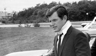 In this July 22, 1969, file photograph, U.S Sen. Edward Kennedy, D-Mass., arrives back home in Hyannis, Mass., after attending the funeral of Mary Jo Kopechne in Pennsylvania. Kopechne drowned when a car driven by Kennedy went off a bridge on Chappaquiddick Island, at the eastern end of Martha's Vineyard. It's been 50 years since the fateful automobile accident that killed a woman and thwarted Kennedy's presidential aspirations. (AP Photo/Frank C. Curtin, File)