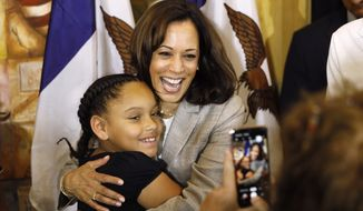 Democratic presidential candidate Sen. Kamala Harris, D-Calif., gets a hug from Kyrah Cortimiglia, of San Diego, California, following a Women of Color roundtable discussion, Tuesday, July 16, 2019, in Davenport, Iowa. (AP Photo/Charlie Neibergall)