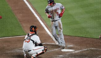 Washington Nationals' Brian Dozier (9) touches home in front of Baltimore Orioles catcher Chance Sisco (15) after Dozier was awarded home plate on a balk by relief pitcher Shawn Armstrong during the sixth inning of a baseball game Tuesday, July 16, 2019, in Baltimore. The Nationals won 8-1. (AP Photo/Julio Cortez) ** FILE **