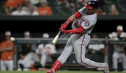 Washington Nationals' Juan Soto singles in Adam Eaton during the ninth inning of a baseball game against the Baltimore Orioles, Tuesday, July 16, 2019, in Baltimore. The Nationals won 8-1. (AP Photo/Julio Cortez)