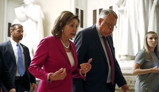 House Speaker Nancy Pelosi of Calif., left, walks out of the House Chamber, Tuesday, July 16, 2019, on Capitol Hill in Washington. (AP Photo/Patrick Semansky)