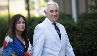 Roger Stone, a longtime confidant of President Donald Trump, accompanied by his wife Nydia Stone, left, arrives at federal court in Washington, Tuesday, July 16, 2019. (AP Photo/Sait Serkan Gurbuz)