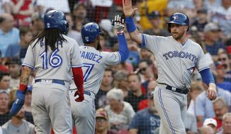 Toronto Blue Jays' Teoscar Hernandez (37) celebrates his three-run home run that scored Freddy Galvis (16) and Justin Smoak, right, during the second inning of a baseball game against the Boston Red Sox in Boston, Tuesday, July 16, 2019. (AP Photo/Michael Dwyer)