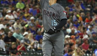 Arizona Diamondbacks Ildemaro Vargas gestures as he approaches home plate after a two-run home run against the Texas Rangers during the sixth inning of a baseball game Tuesday, July 16, 2019. in Arlington, Texas. (AP Photo/Richard W. Rodriguez)