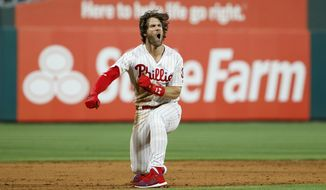 Philadelphia Phillies' Bryce Harper celebrates after hitting a game-winning two-run double off Los Angeles Dodgers relief pitcher Kenley Jansen during the ninth inning of a baseball game Tuesday, July 16, 2019, in Philadelphia. Philadelphia won 9-8. (AP Photo/Matt Slocum)