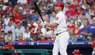 Philadelphia Phillies' Jay Bruce reacts after striking out against Los Angeles Dodgers starting pitcher Walker Buehler during the first inning of a baseball game, Tuesday, July 16, 2019, in Philadelphia. (AP Photo/Matt Slocum)