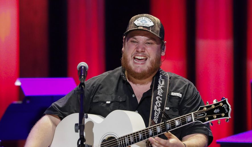 In this file photo, Luke Combs performs at ';Luke Combs Joins the Grand Ole Opry Family' at the Grand Ole Opry, Tuesday, July 16, 2019, in Nashville, Tenn. Mr. Combs was among the headliners that were to perform at the now-canceled 2020 Carolina Country Music Fest. Originally scheduled for June, it had been postponed to September 17,  but organizers pulled the plug on event on August 11, citing the ongoing coronavirus pandemic. (Photo by Al Wagner/Invision/AP)
