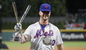 "FILE - This July 8, 2019 file photo shows Pete Alonso, of the New York Mets, after winning the Major League Baseball Home Run Derby in Cleveland. The Nielsen company says a little more than 8 million people watched Tuesday's All-Star game on Fox, enough to be the second-most popular thing on television after ""America's Got Talent"" last week. The derby where sluggers flex their muscles a day before the game was televised on ESPN and reached a respectable 5.4 million viewers. (AP Photo/John Minchillo, File)"