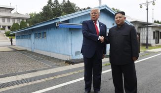 In this June 30, 2019, file photo, U.S. President Donald Trump, left, meets with North Korean leader Kim Jong-un at the border village of Panmunjom in the Demilitarized Zone, South Korea. North Korea on Tuesday, July 16, 2019, says it is rethinking whether to abide by its moratorium on nuclear and missile tests and other steps aimed at improving ties with the U.S. (AP Photo/Susan Walsh, File)