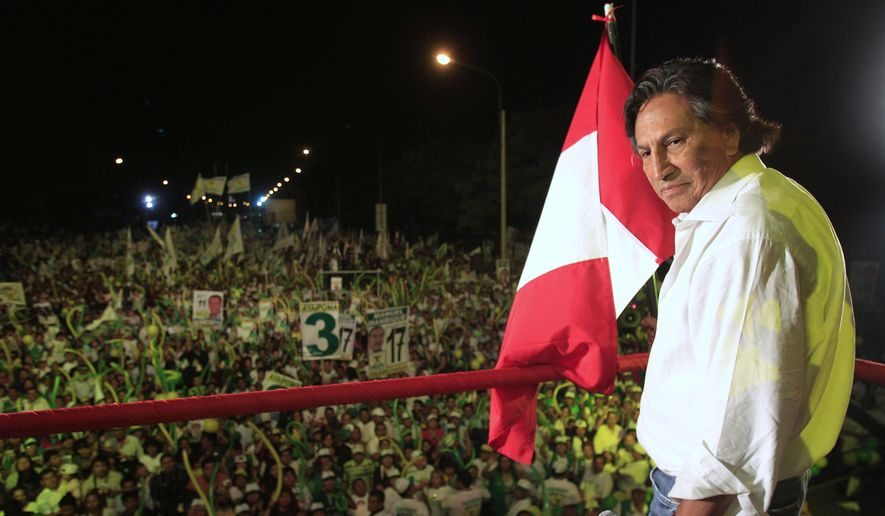 In this April 7, 2011 file photo, then presidential candidate Alejandro Toledo takes part in a campaign rally in Lima, Peru. The Peruvian public prosecutor's office said Tuesday, July 16, 2019, that the Toledo the former president was arrested in the United States where he currently resides, on an extradition order requested by Peru to stand trial for a corruption case involving Brazilian construction company Odebrecht. (AP Photo/Martin Mejia, File)