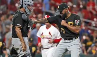 Pittsburgh Pirates relief pitcher Felipe Vazquez, right, celebrates with catcher Elias Diaz after the team's 3-1 victory over the St. Louis Cardinals in a baseball game Tuesday, July 16, 2019, in St. Louis. (AP Photo/Jeff Roberson)