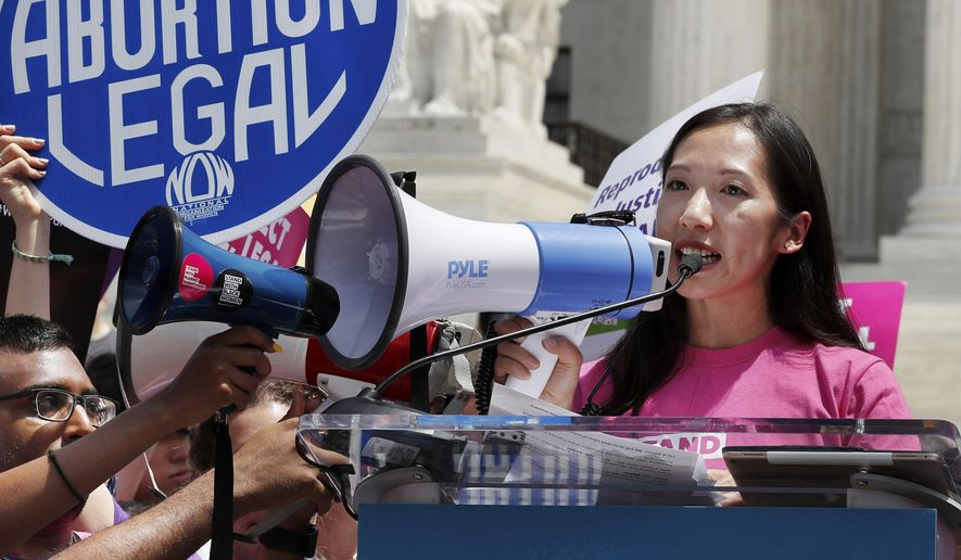 """FILE - In this Tuesday, May 21, 2019 file photo, Planned Parenthood President Leana Wen speaks during a protest against abortion bans outside the Supreme Court in Washington. On Tuesday, July 16, 2019, Wen, who became the president in November 2018, was forced out of her job. In a statement posted on Twitter, she said she had """"philosophical differences"""" with the new chairs of Planned Parenthood's board regarding abortion politics. (AP Photo/Jacquelyn Martin)"""